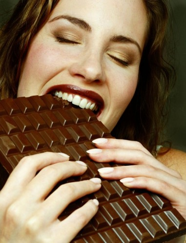 woman-biting-huge-chocolate-bar